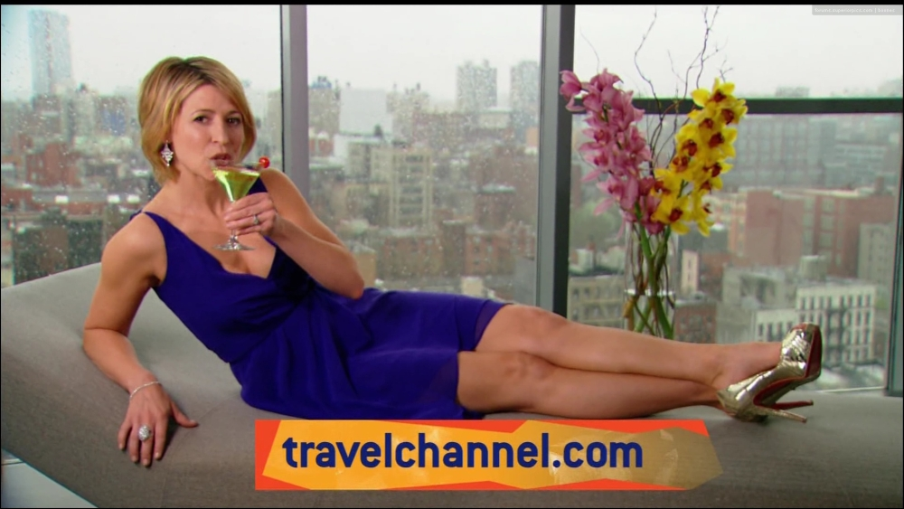 Samantha Brown lounging with a cocktail