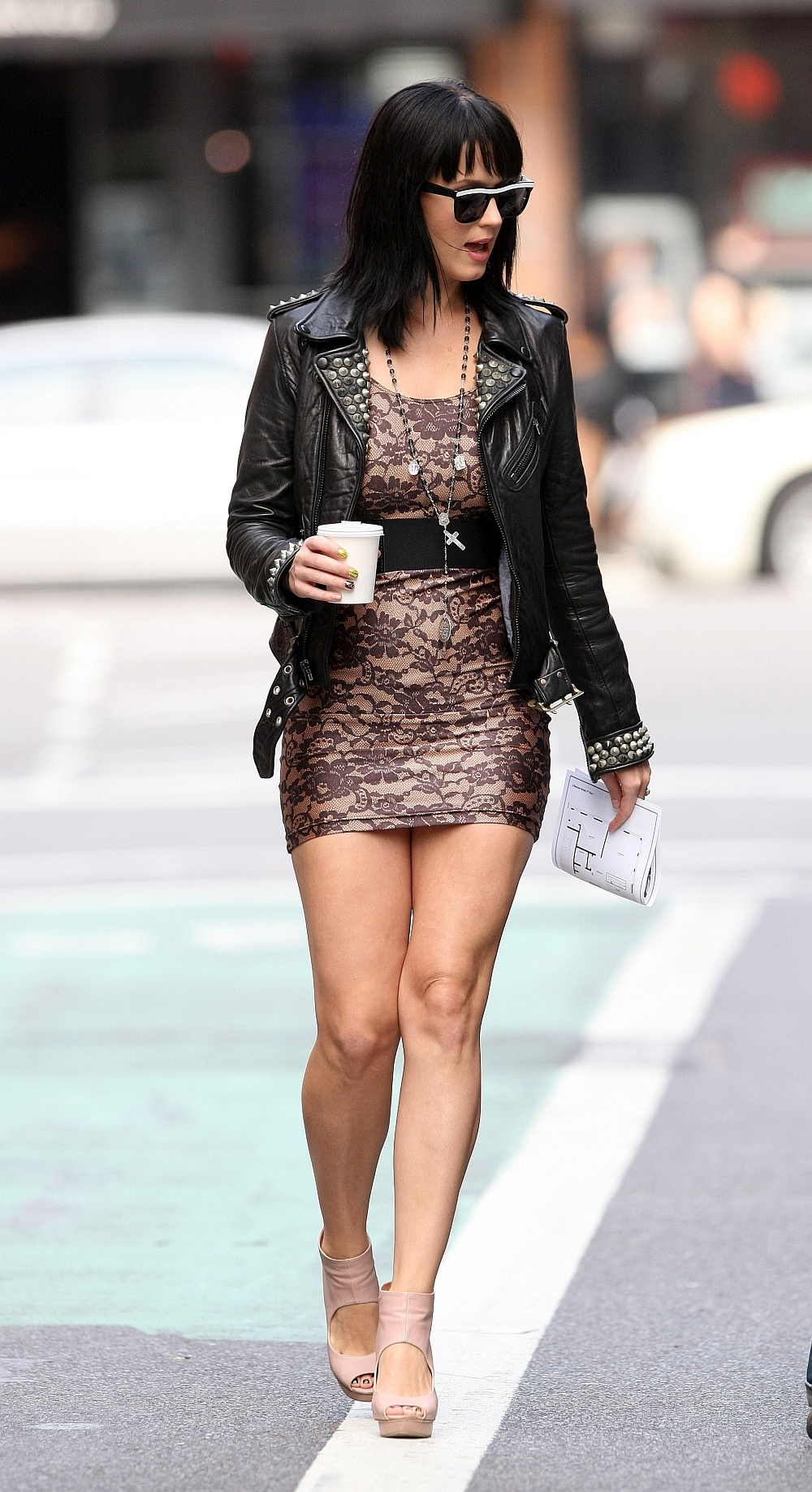 ... Katy Perry has hot legs in a mini dress and high heels
