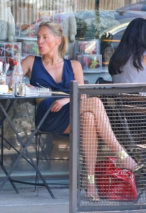 Sharon Stone crosses her sexy legs in high heels