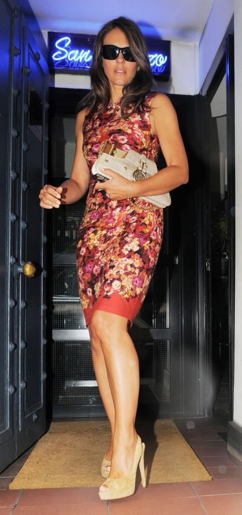 Elizabeth Hurley sexy legs and high heels