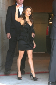 Eva Longoria in a little black dress and satin high heels