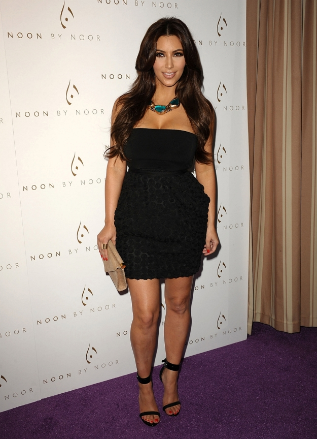 kim kardashian sexy legs in little black dress and high heels
