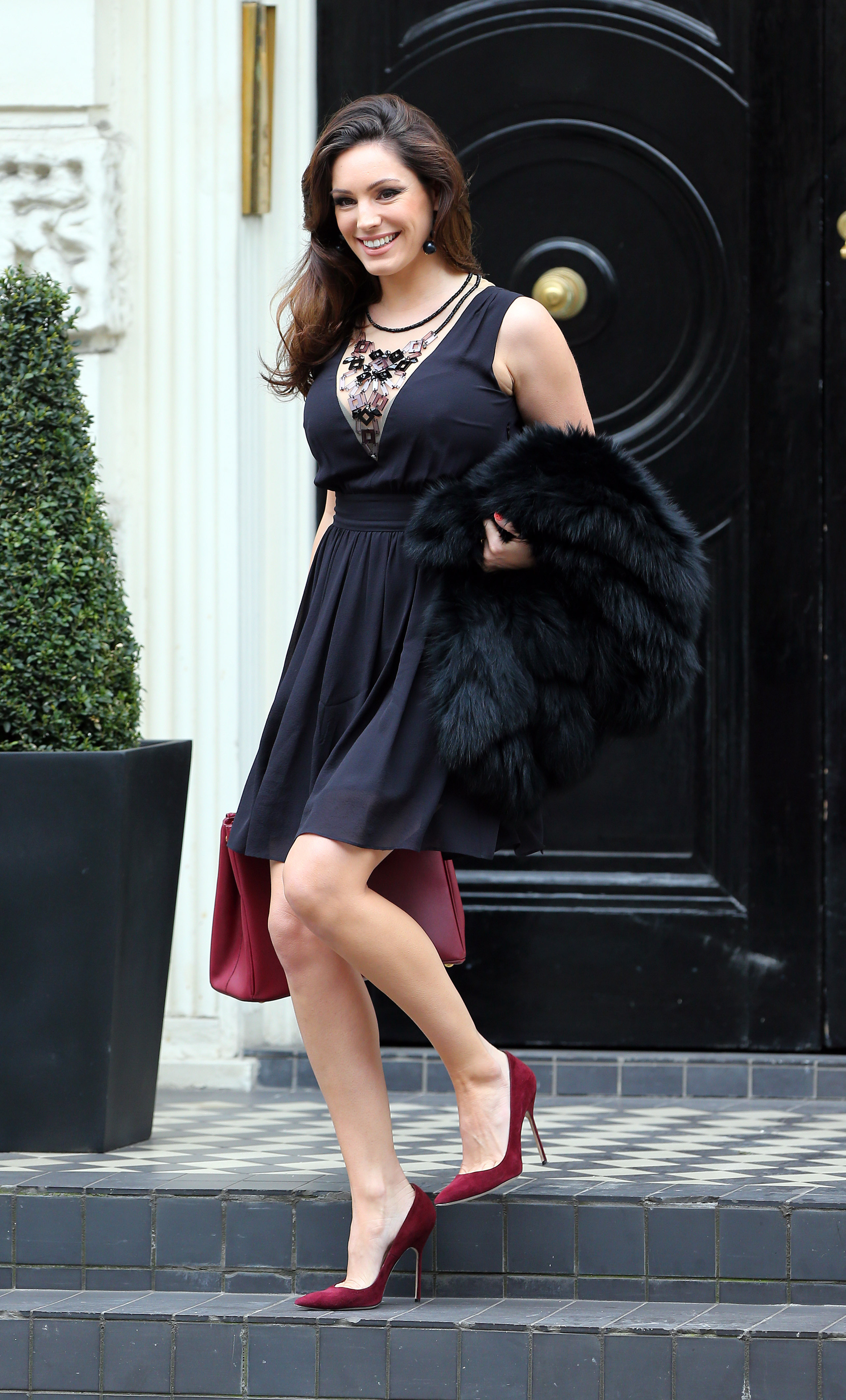 4a13a4cb656 Kelly Brook in a Little Black Dress and Red High Heels