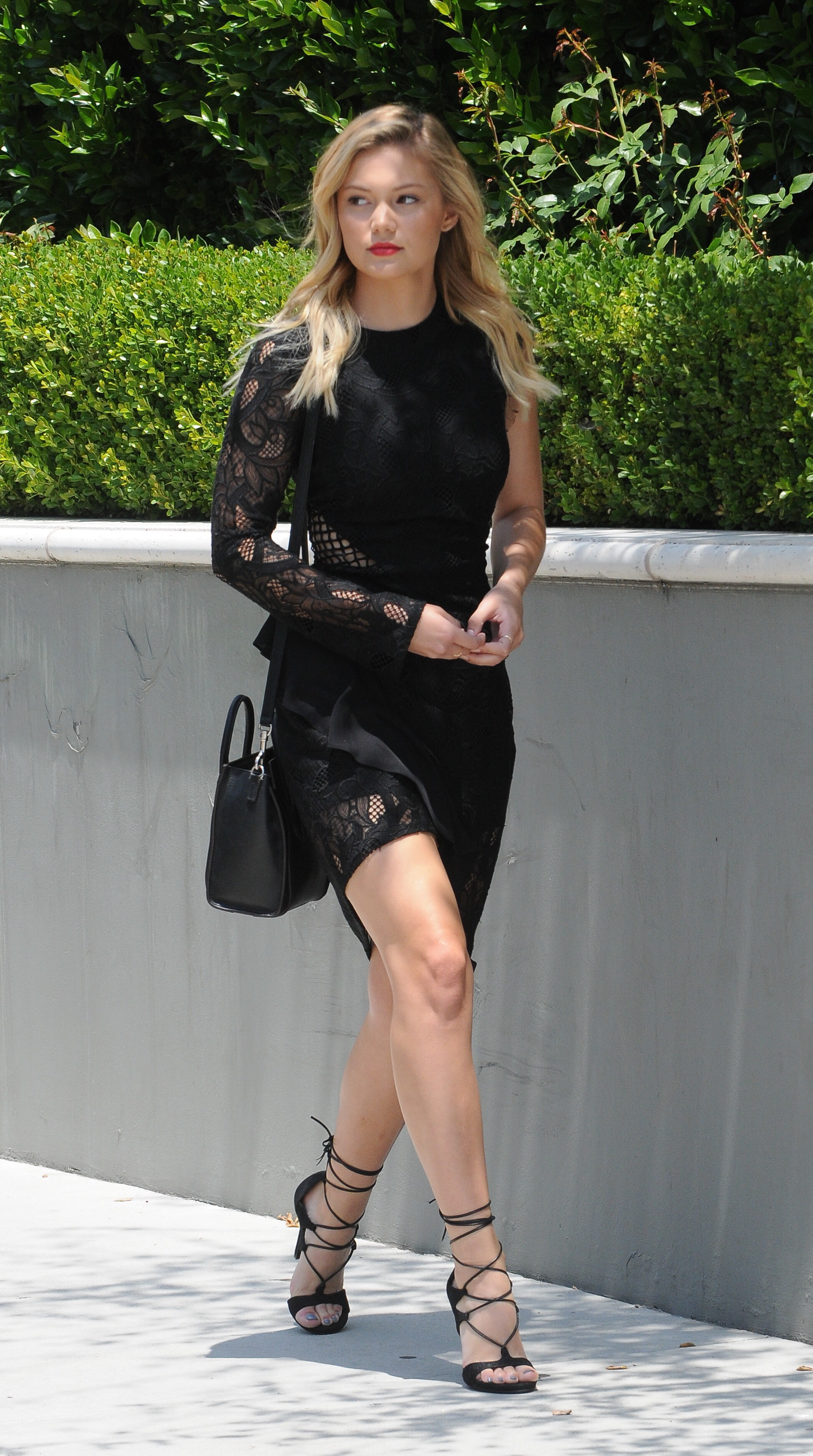 Fotos De Olivia Holt olivia holt sexy in a little black lace number and strappy
